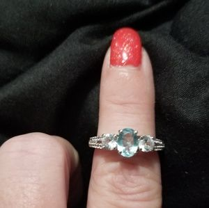 Aquamarine and white topaz ring